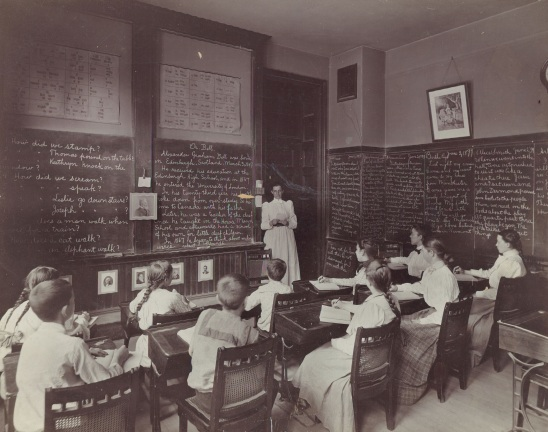 Classroom scene with teacher Ida Adams conducting a lesson on Alexander Graham Bell (Horace Mann School photographs, Collection 0420.047, City of Boston Archives, Boston: 1899)